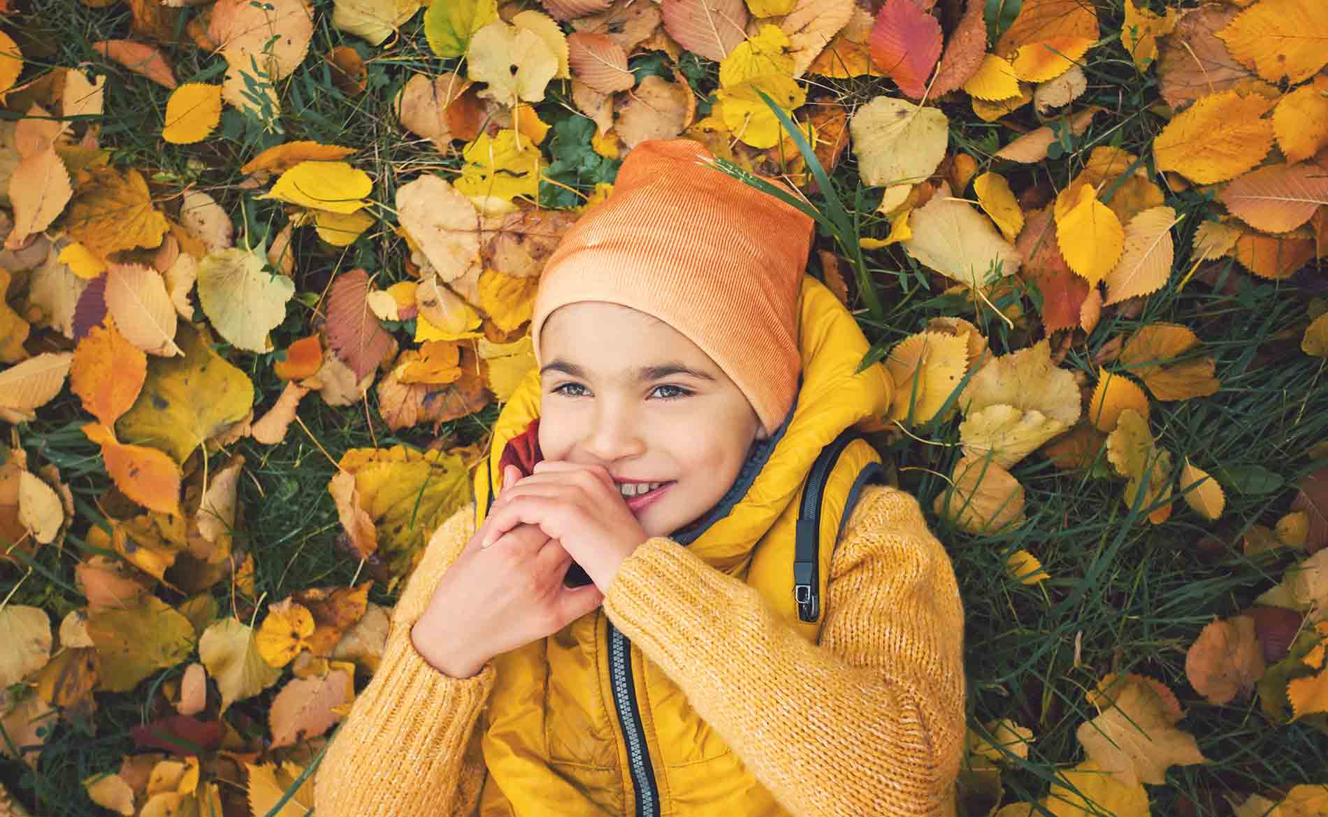 Boy with Cerebral Palsy Playing in Leaves